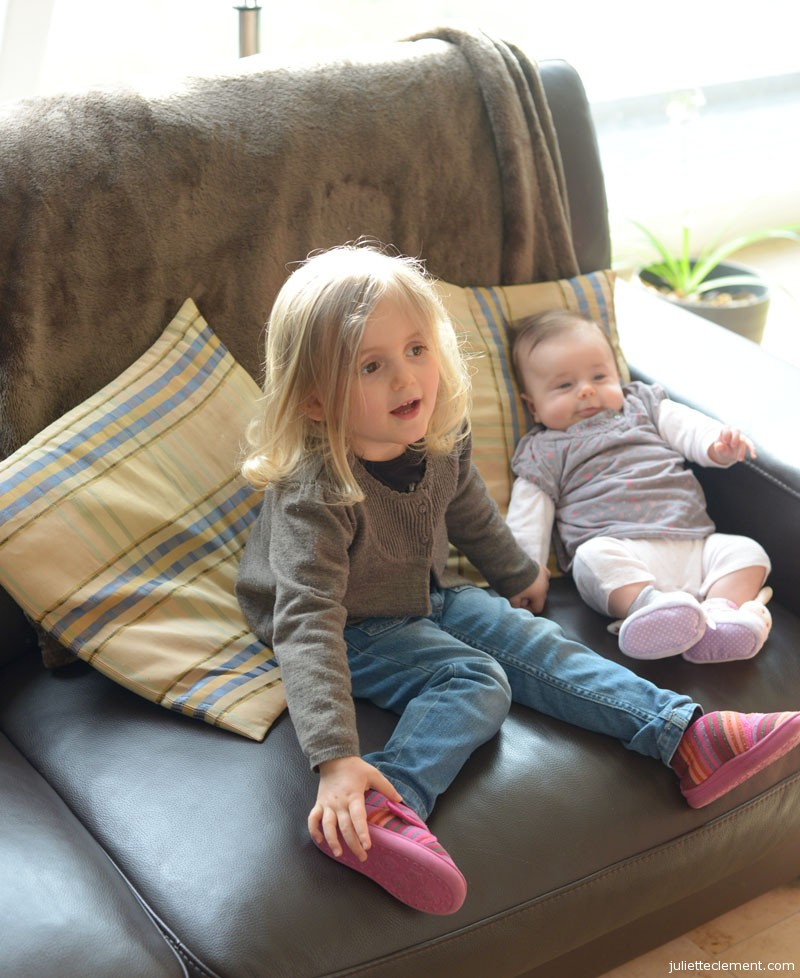 Two girls, hanging out on the couch