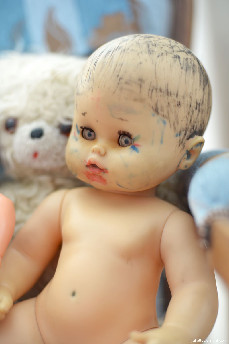 "A doll previously ""decorated"" by Aude as a child"