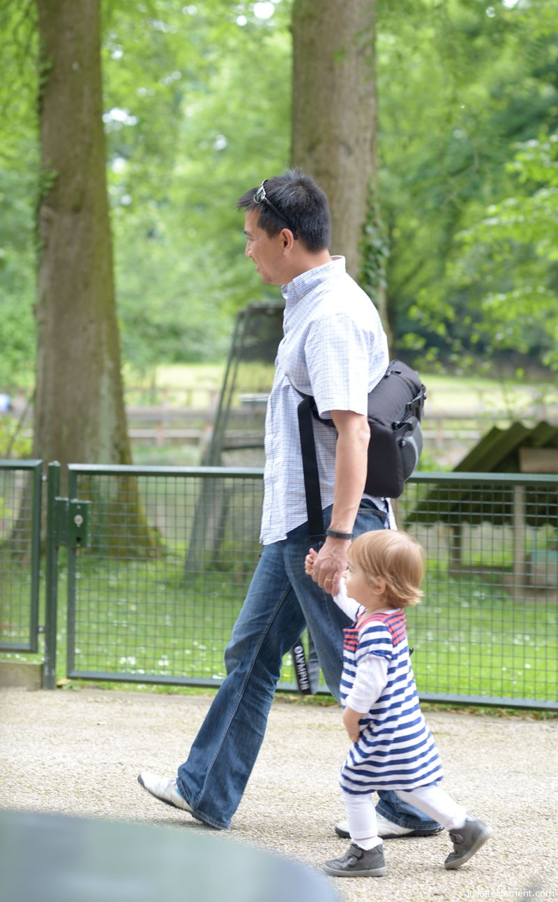 Juliette and her godfather, Bao, explore the zoo together.