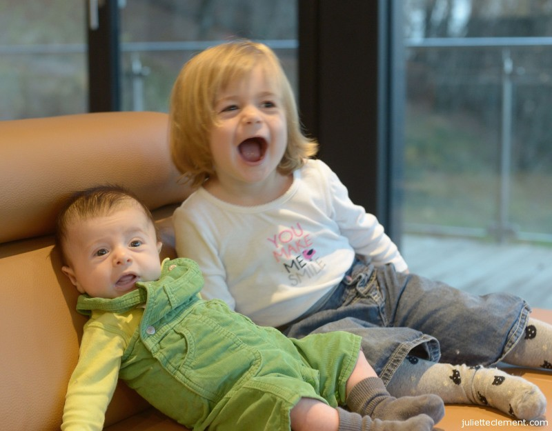 Juliette seems happier about giving her little brother a kiss than Alexandre seems about receiving it!