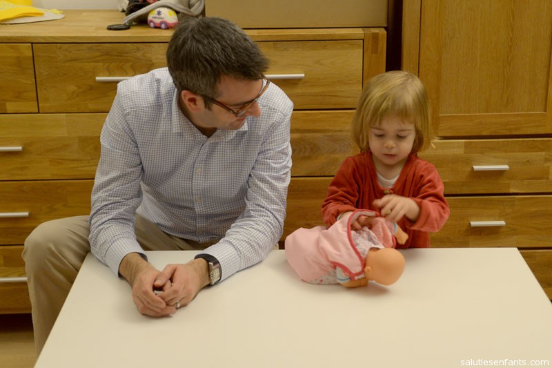 Juliette got a table and two stools for her bedroom.  After moving it several times to get it placed just so, she insisted that Papa join her.