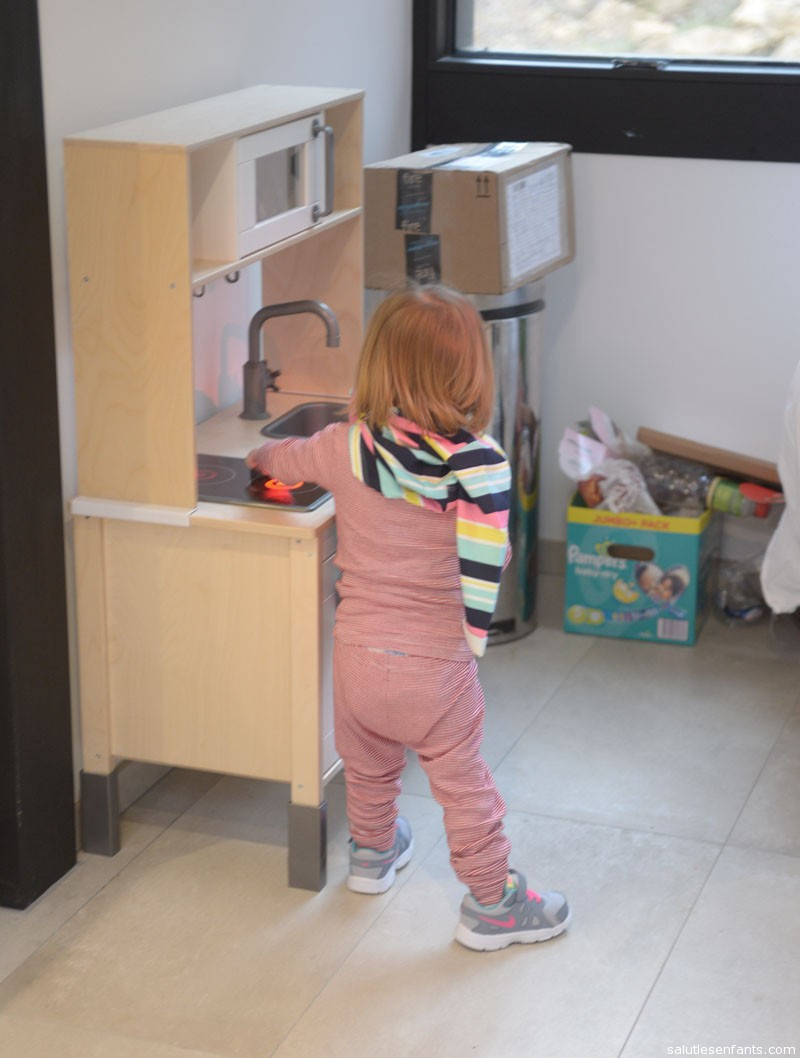 Juliette was very excited by her new kitchen.  So excited, in fact, that she ran over half-way through trying on her new shirt.