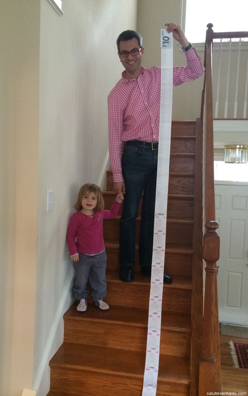 Dad and Juliette pose with the receipt from their shopping trip