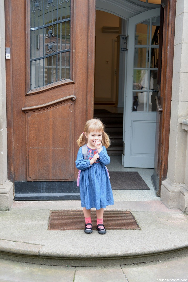 Juliette on the steps of the schoolhouse