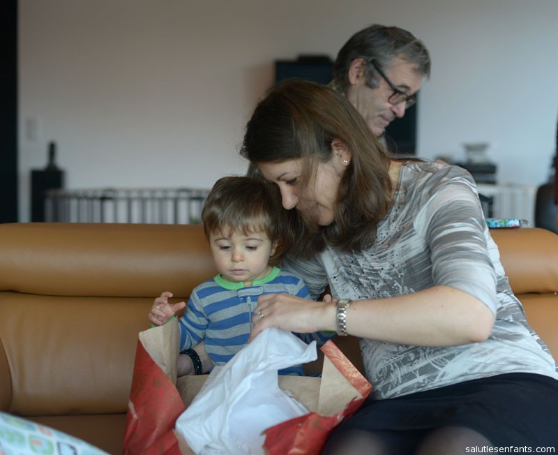 Mom lends a hand to Alex as he opens his presents
