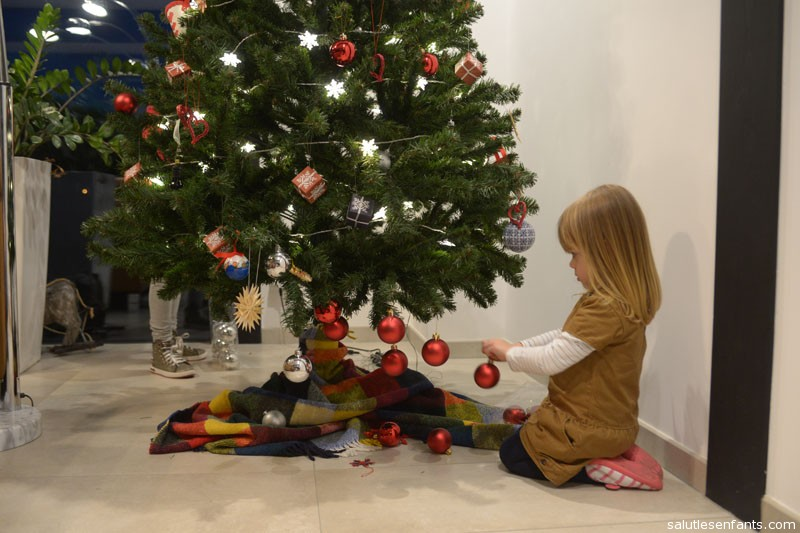 The heavy concentration of red baubles at the bottom might be a design choice.  Or they might be down to Juliette's insistence of decorating the tree without getting up from the floor!