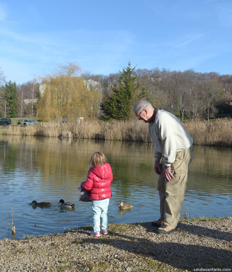 Juliette and Grandpa feeding the ducks