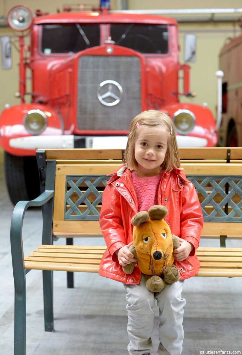 That's a tiny girl and a huge fire engine!